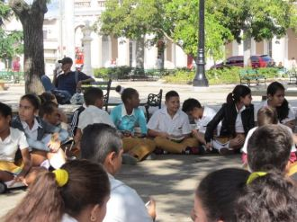 A group of students in the square.