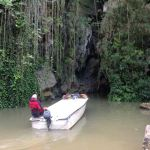 Our boat returns to the cave
